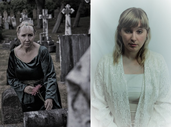 A lady in a black dress sits beside a grave. A girl in a white dress looks out