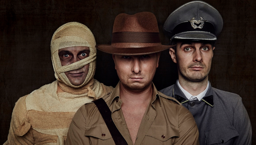 three men dressed as a mummy indiana jones and a nazi soldier