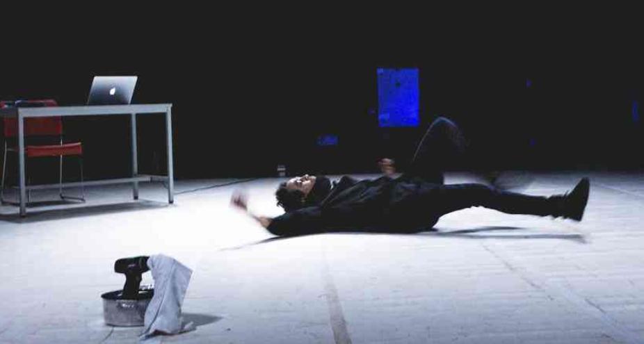 man lying on white floor