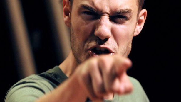 Angry man pointing at camera