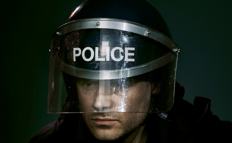 man in police riot uniform