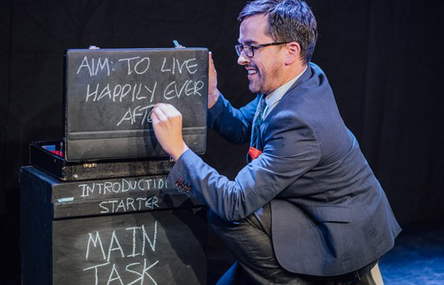 man writing on chalkboard surfaces